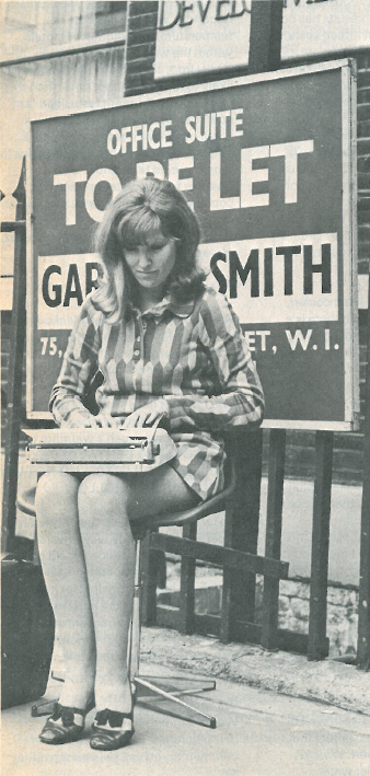Old photograph of woman using a typewriter outdoors