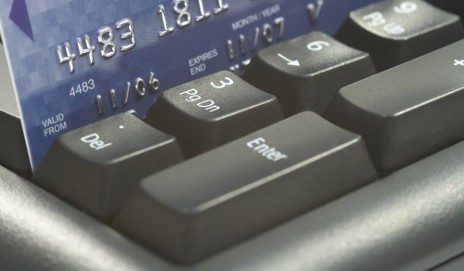 Credit card on computer keyboard
