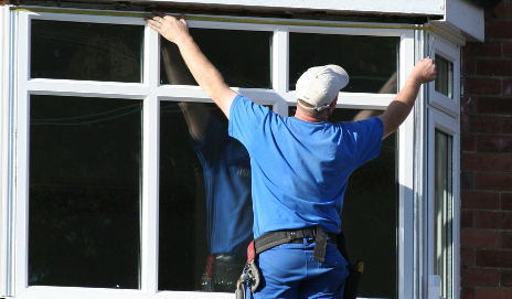 Man fitting windows