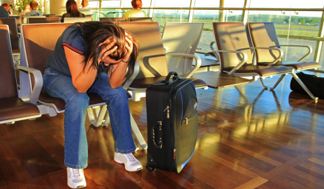 Woman frustrated in airport waiting room