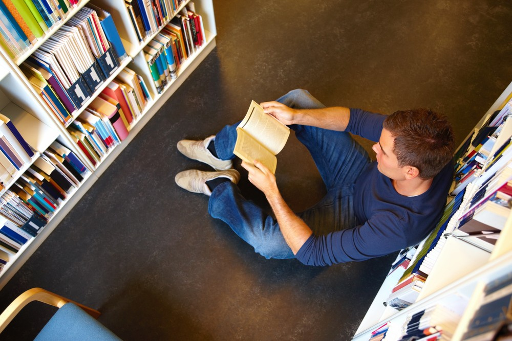 Man sat in library