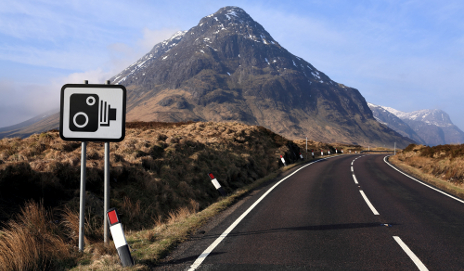 Speed camera sign on road in Scottish highlands