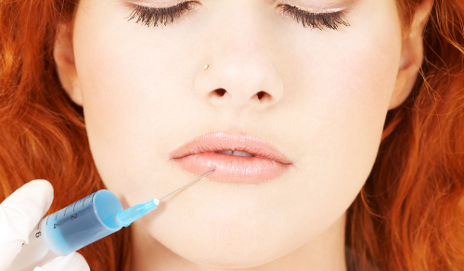 Woman having botox injection in lips