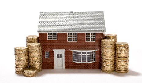 Toy house with pound coins