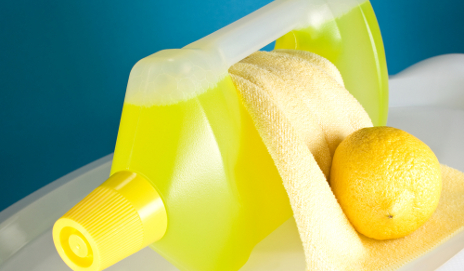 Yellow kitchen cleaner with lemon