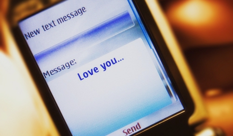 Mobile phone with text saying 'love you'