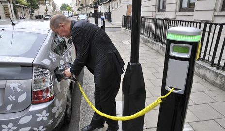 Man charging an electric car