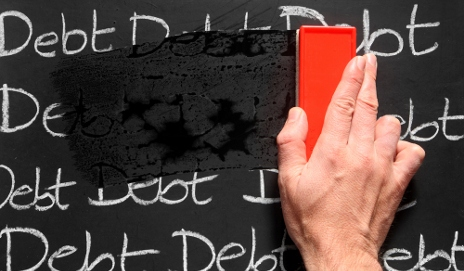 Debt being rubbed out on blackboard