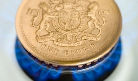 Pound coin on gas hob