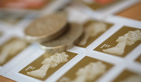 Pound coins on first class stamps