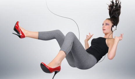 Woman falling while listening to music