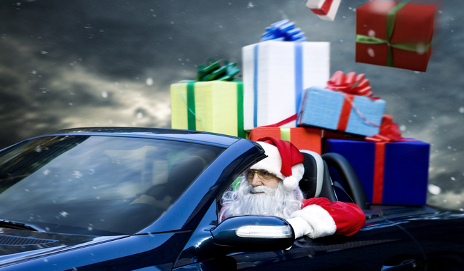 Father Christmas in car with presents