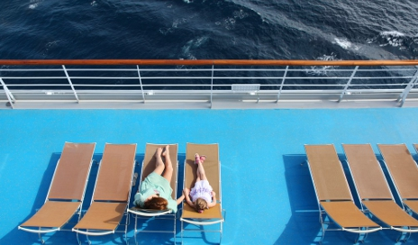 People lounging on cruise deck