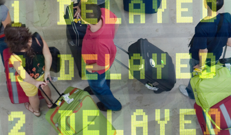 Delayed flights on screen with holidaymakers