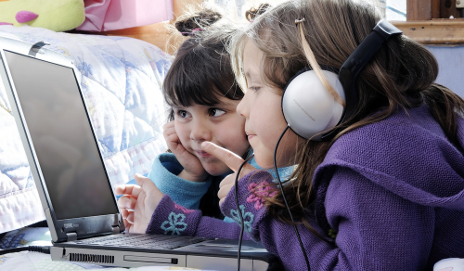 Two children using a laptop