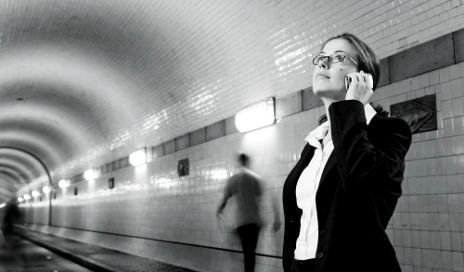 Woman on phone underground