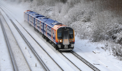 Train driving in snow