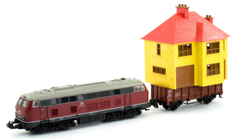 Toy train dragging a toy house