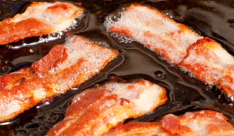 Bacon frying in oil