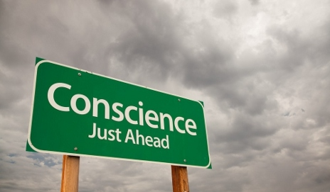 Sign saying 'conscience just ahead'