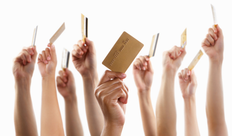 People holding up credit cards