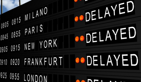 Departure board showing delayed flights