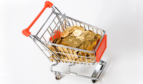 Model supermarket trolley filled with gold coins