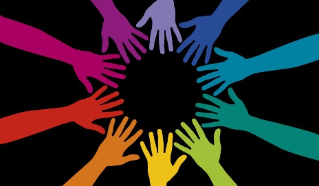 Brightly-coloured hands making a circle