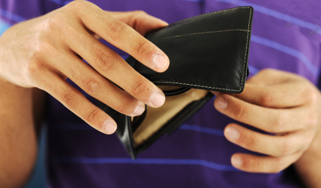 Young person with empty wallet