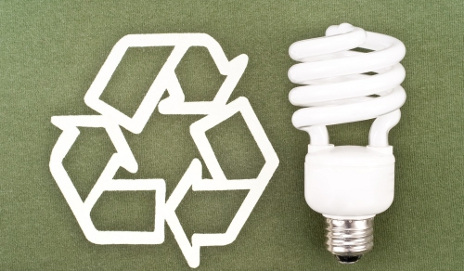 Recycling symbol and energy-saving bulb