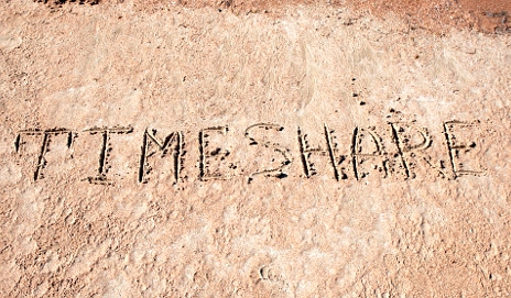 'Timeshare' written in sand