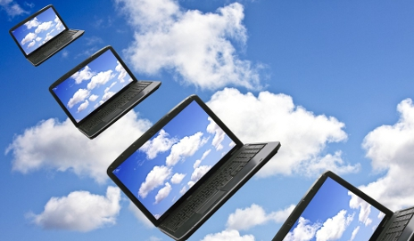 Laptops floating in clouds