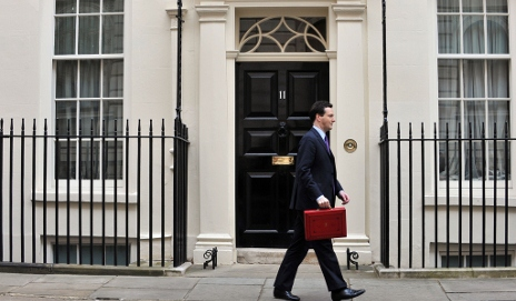 Chancellor of the Exchequer George Osborne holding the red budget box, photo by Andrew Parsons