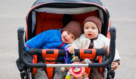 Children in two-seater pushchair