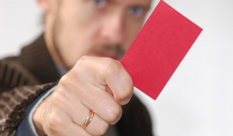 Man holding up a red card