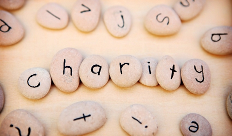 Pebbles with letters spelling out the word 'charity'