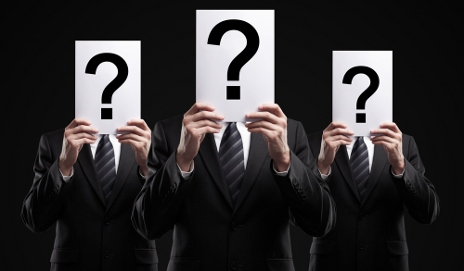 Business men with question marks