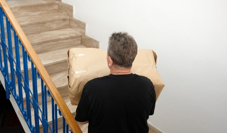 Man carrying package upstairs