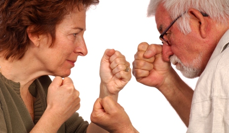 Elderly woman and man fighting