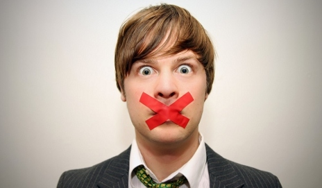 Man with red tape on his mouth