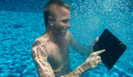 Man using a tablet underwater