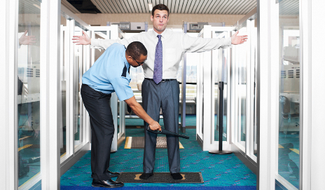 Man being checked at airport security