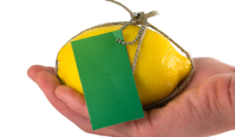 Lemon with a green label