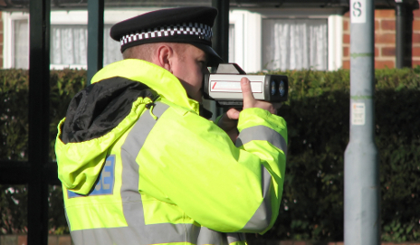 Police with handheld speed camera