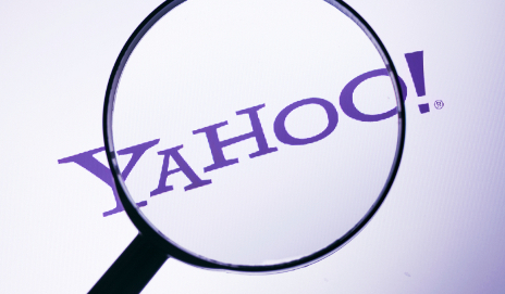 Yahoo! logo through magnifying glass