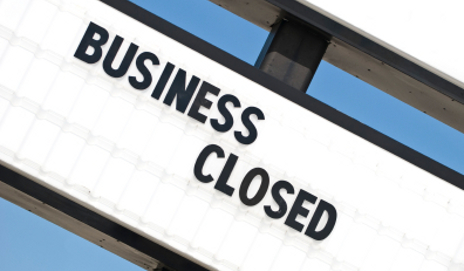 Sign saying 'business closed'