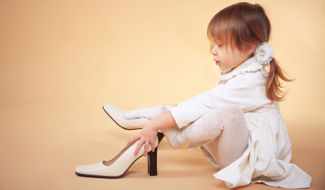 Child trying on high heels