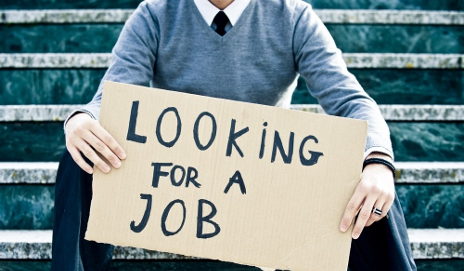 Young man holding an unemployed sign