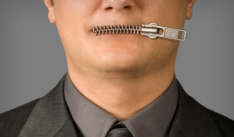 Man with zipped mouth