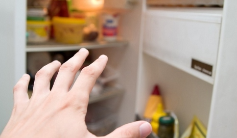 Hand reaching for fridge